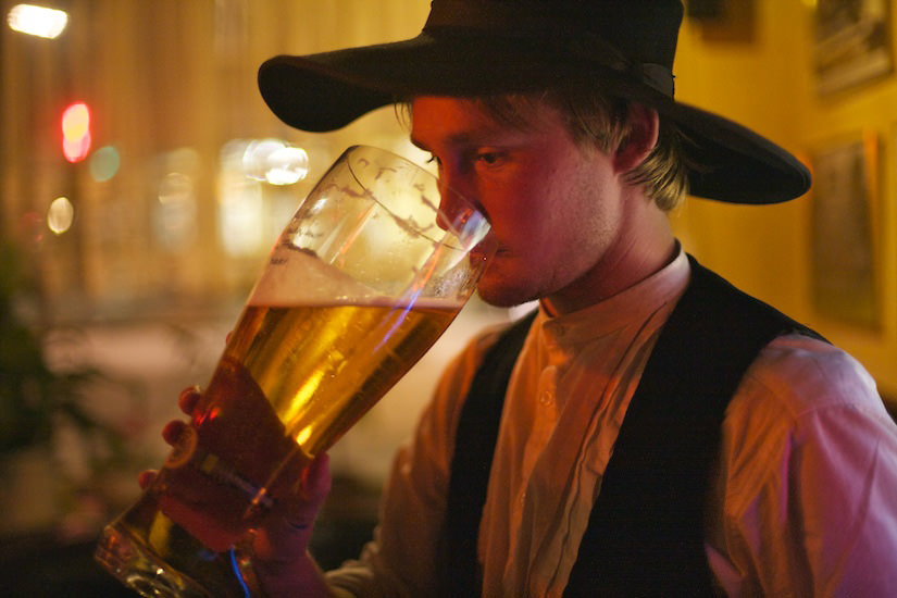 Drinking beer out of a traditional glass boot in Hamburg, Germany